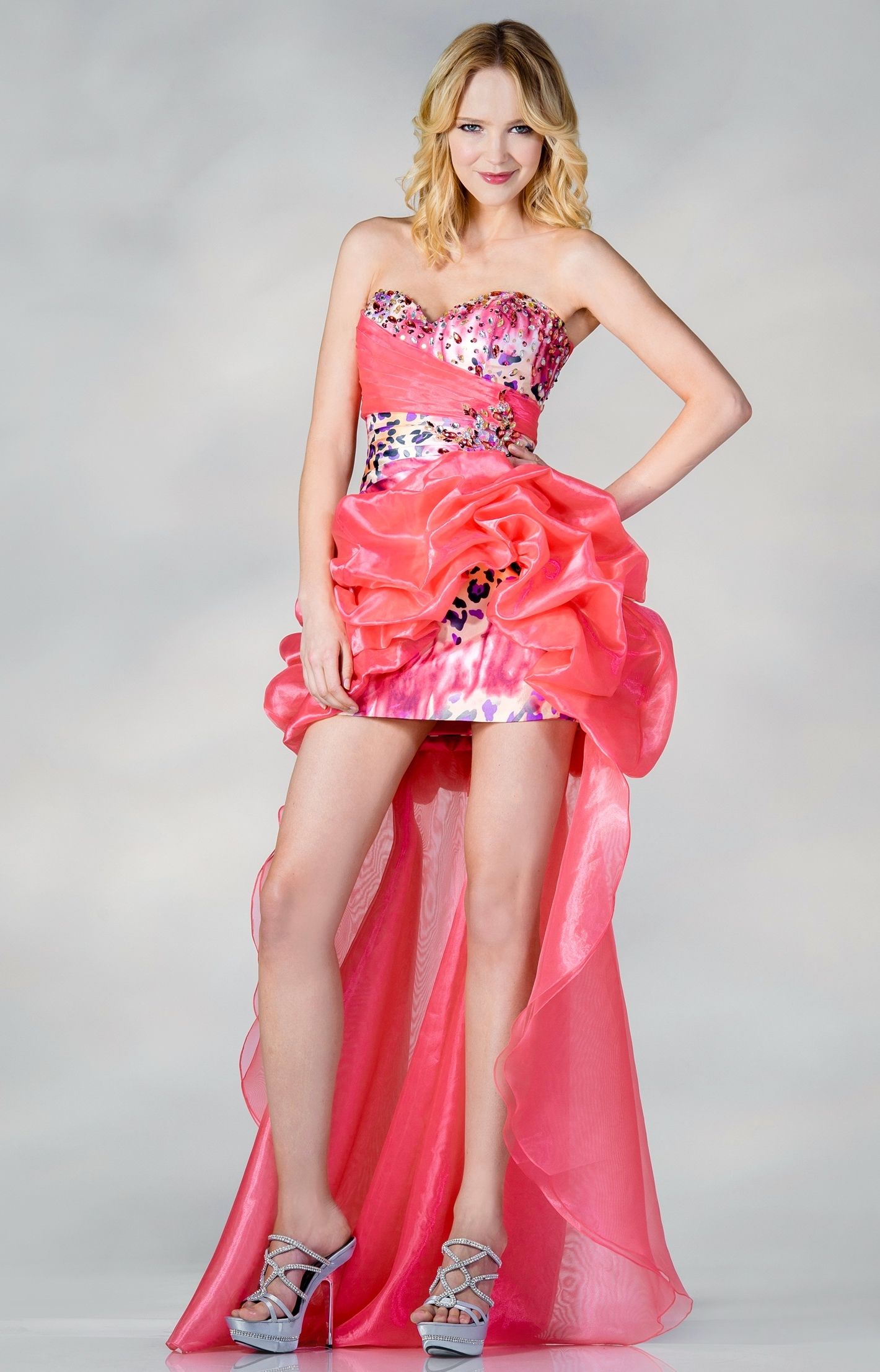 This is a strapless mini dress with organza hilo overlay