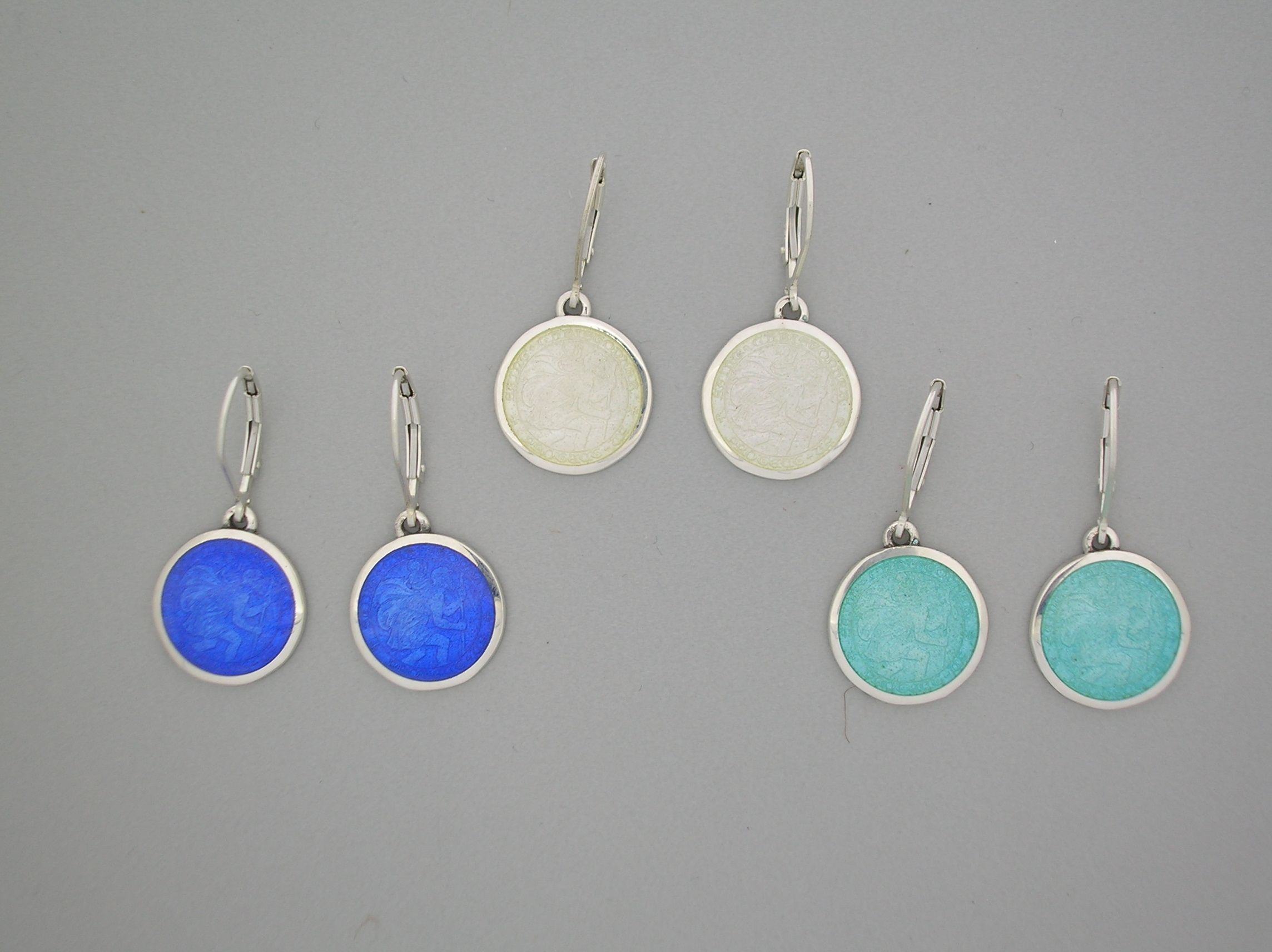 Try The Dangle St Christopher Earrings For A Sophisticated Touch Featured From Left To Right Royal Blue White And Light