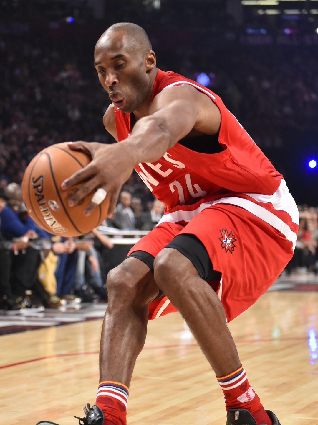 Western Conference forward Kobe Bryant chases down a loose