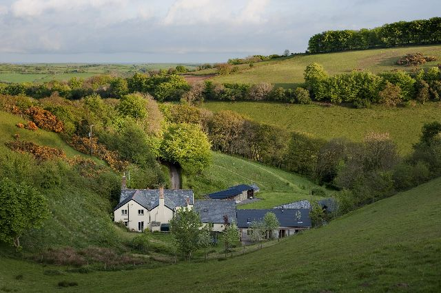 Copper Kettle Cottage nestles amongst farm buildings at Down Farm in a picturesque valley on the edge of Exmoor