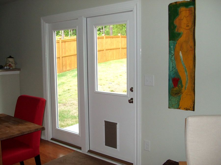 This durham nc homeowner wanted an easy way to let her - Exterior doors with built in pet door ...