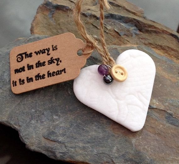 Handmade hanging heart, made from clay with a lace imprint, and decorated with gemstones (picture shows amethyst and hematite). It includes a