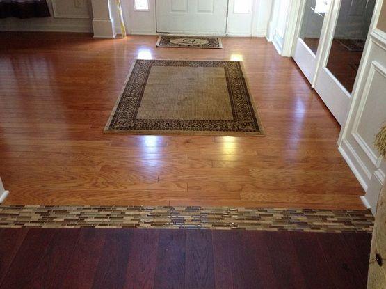 Different Wood Floors In House With Glass Tile Border Flooring Ideas Floor Design Tr Transition Flooring Tile Floor Living Room Living Room Hardwood Floors