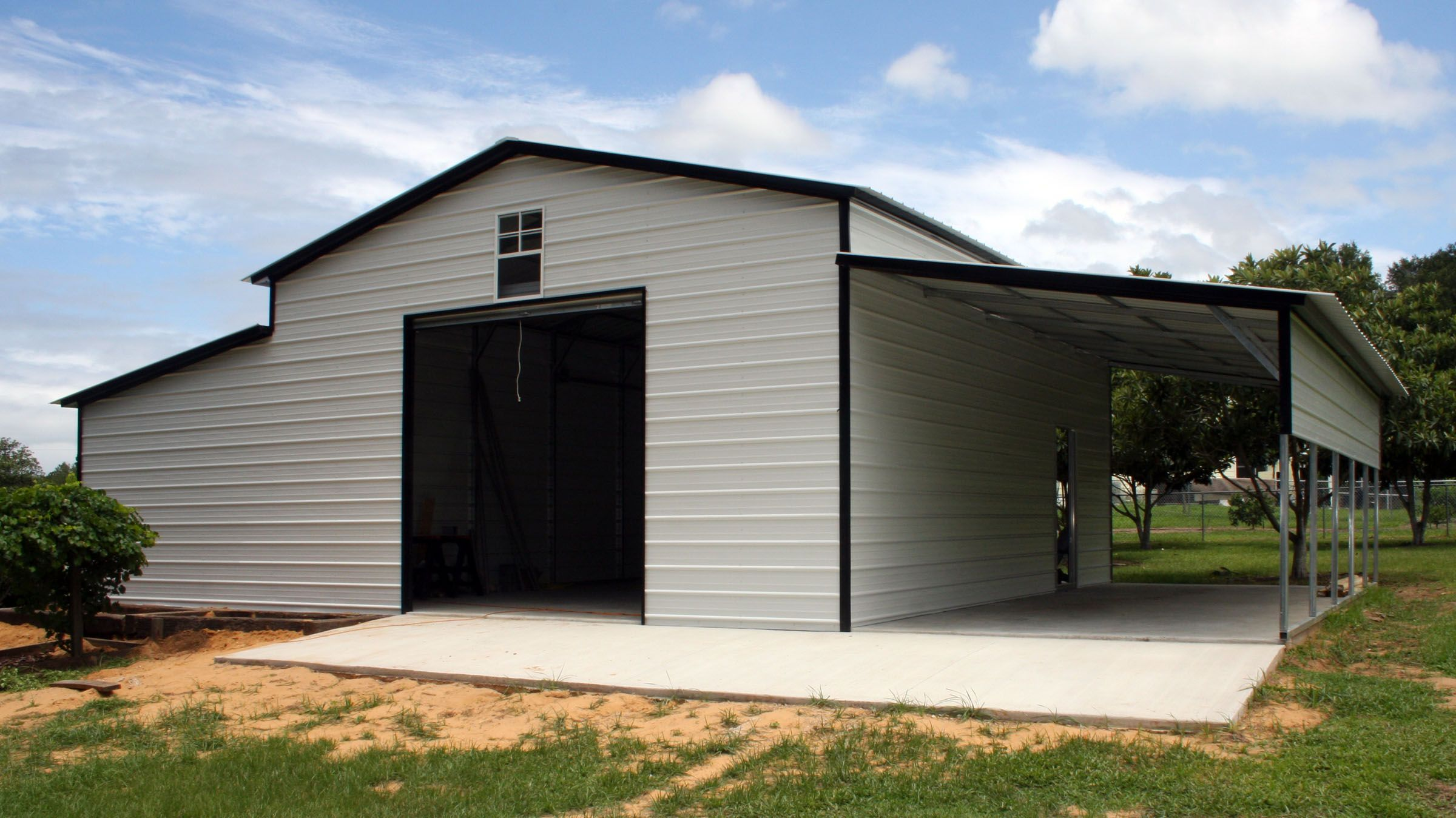 Metal barns with living quarters barn white black open for Custom garages with living quarters
