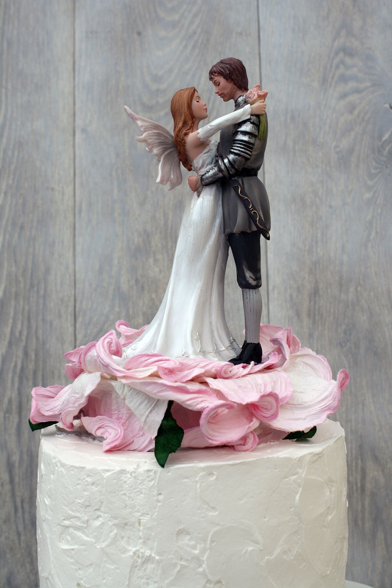 P The Bride And Groom Are Set On A Porcelain Base Wrapped In A