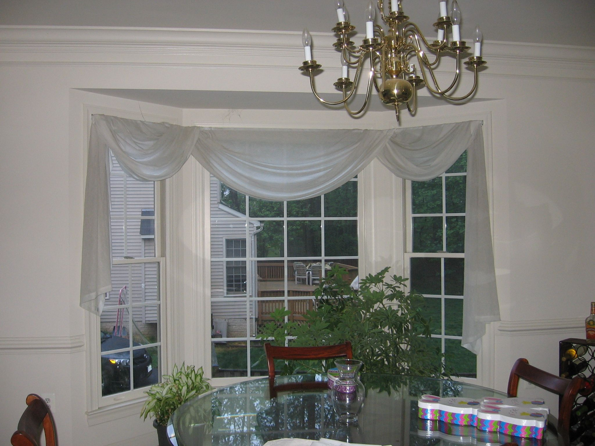 Triple bay window w scarf treatment dining room ideas for Coverings for bay windows