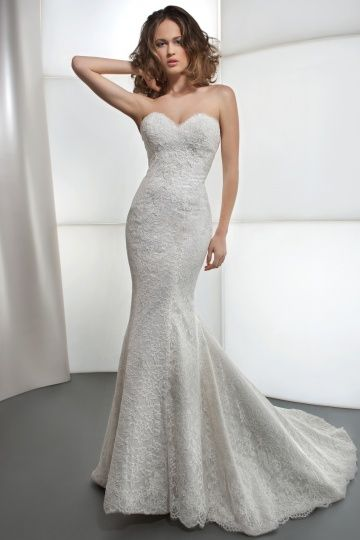 Fitted lace gown with eyelash trim around the entire bottom and bodice top.  Plunging back.  Wow!  Available at Petrov Bridal.
