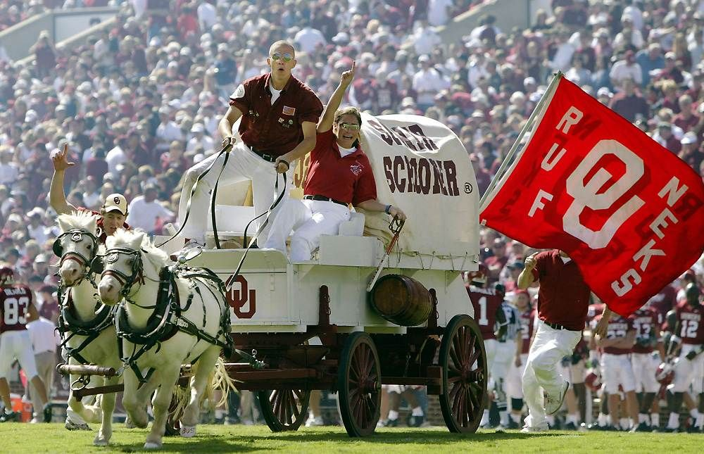 Oklahoma Sooners mascots Boomer and Sooner pull the