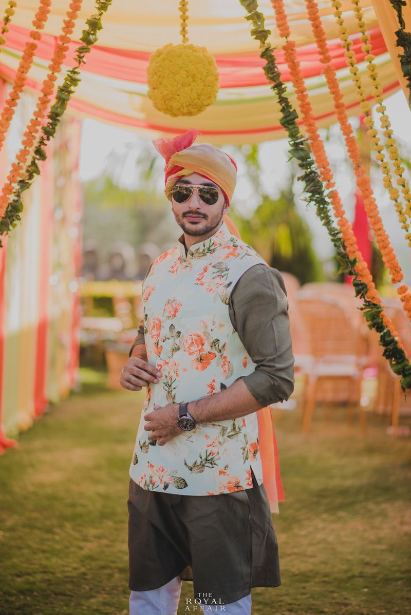 Mehendi groomwear with white and peach floral print nehru jacket in