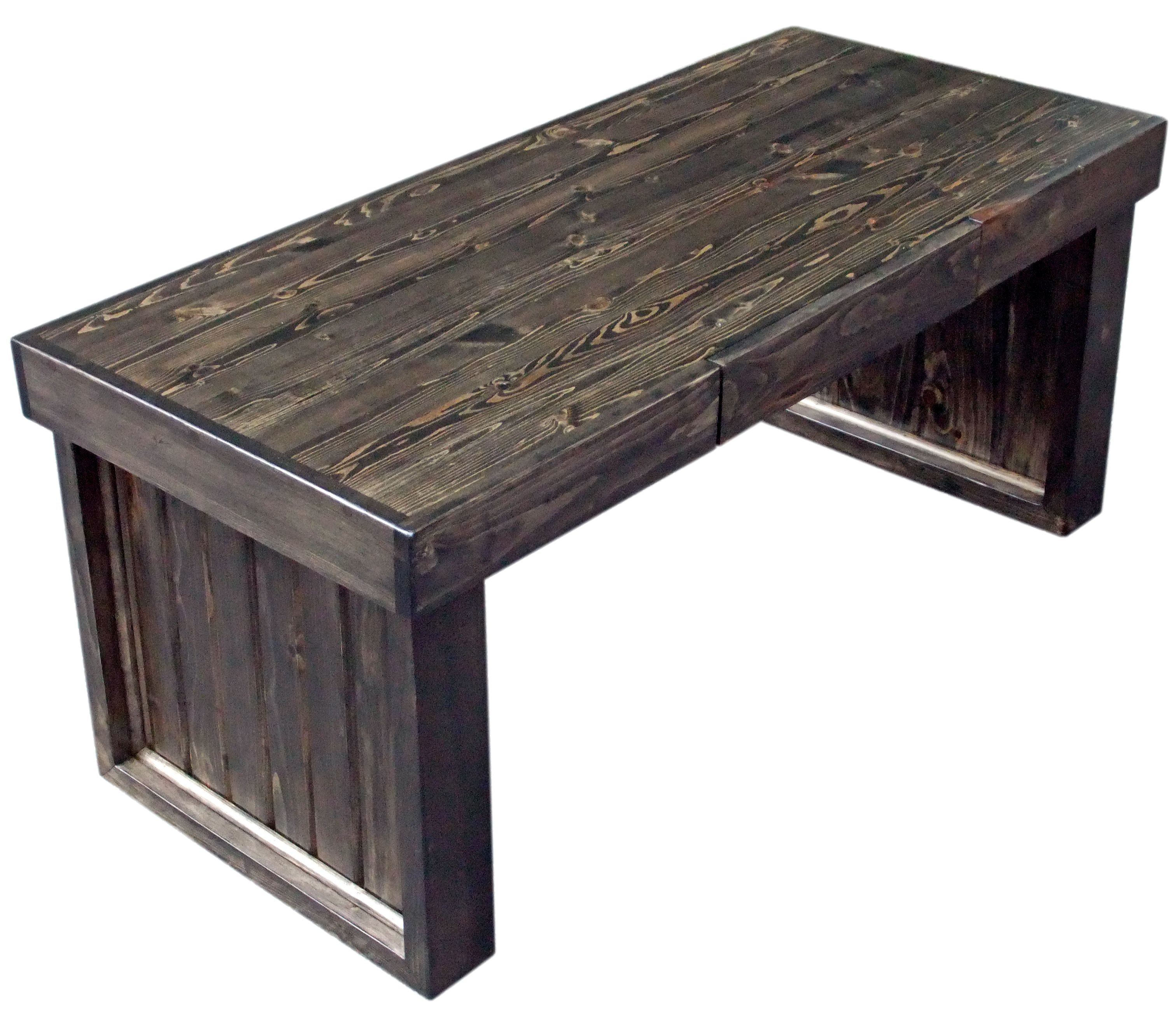 This rugged looking pine coffee table is finished with ebony stain
