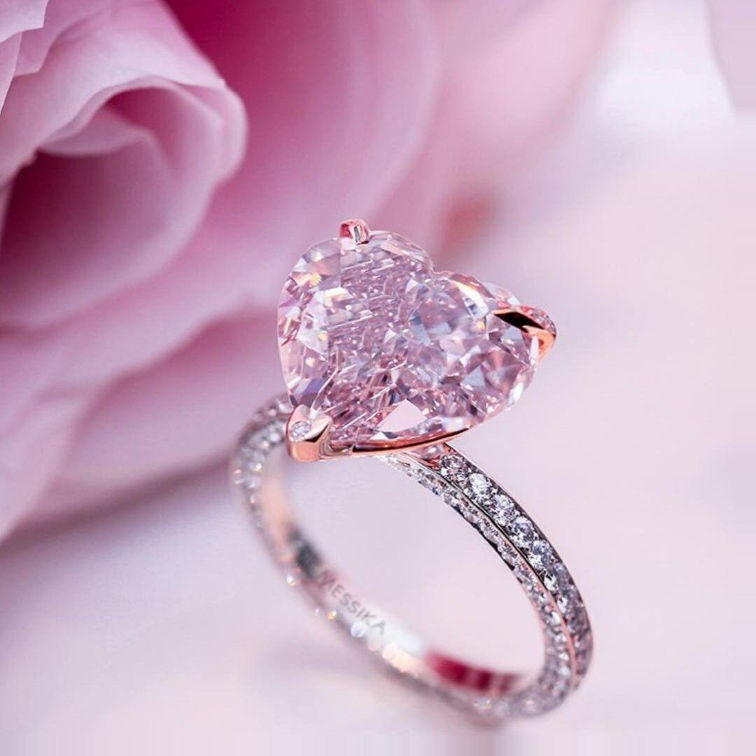 Just look how beautifully bead-set diamonds surround a pink striking ...