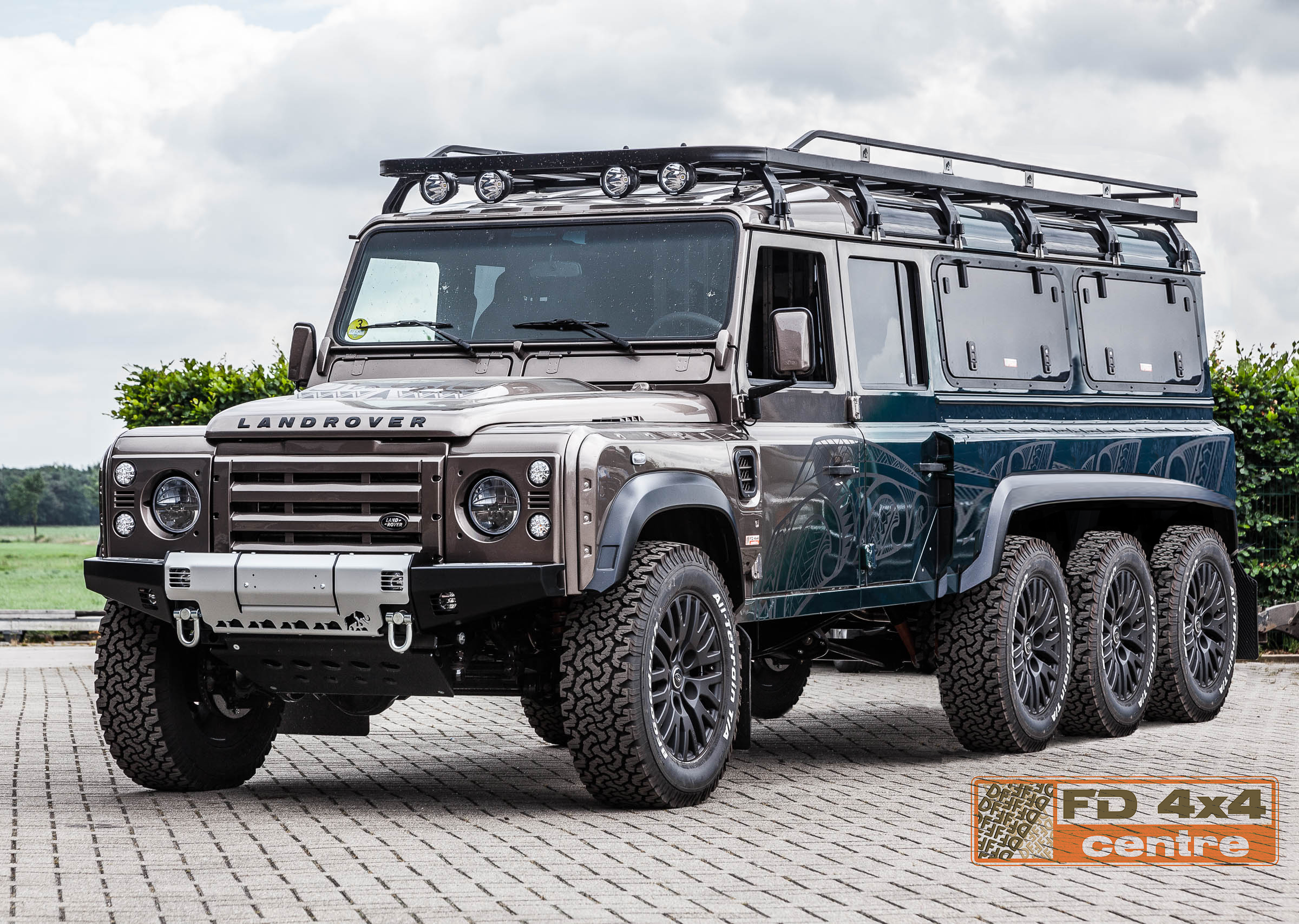 land rover defender 8x8 by fd 4x4 centre with a nice roof rack and bumper from tembo 4x4. Black Bedroom Furniture Sets. Home Design Ideas