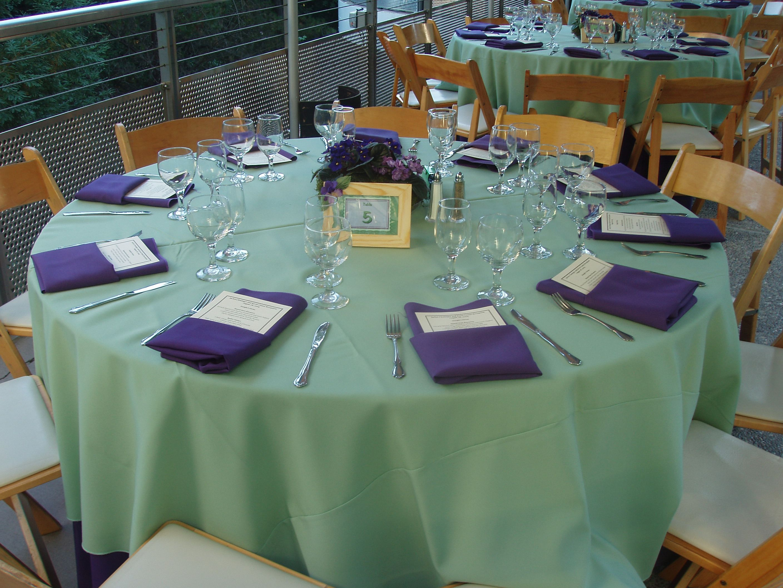 celadon linens and regal purple napkins buffet place setting