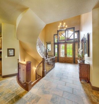 This grand entry features an amazing light fixture, curved ...