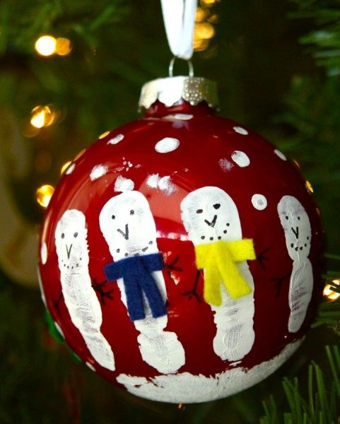 Hand print snowman ornament --- used plastic ornaments from the Dollar  Store --- all 31 of my second grade students made one for their parent gift. - Hand Print Snowman Ornament --- Used Plastic Ornaments From The