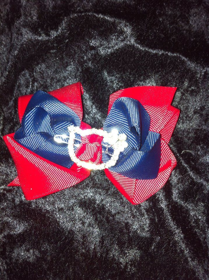 Blue and red bow with hello kitty clip. $6