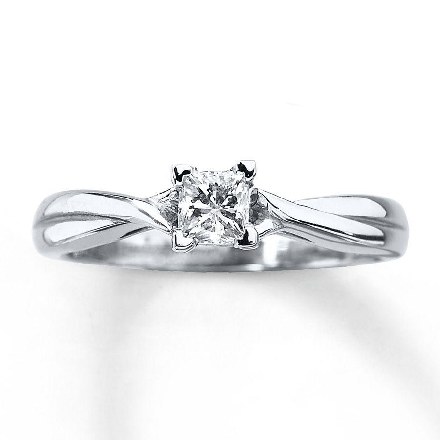 A dazzling carat princesscut diamond is the centerpiece of this