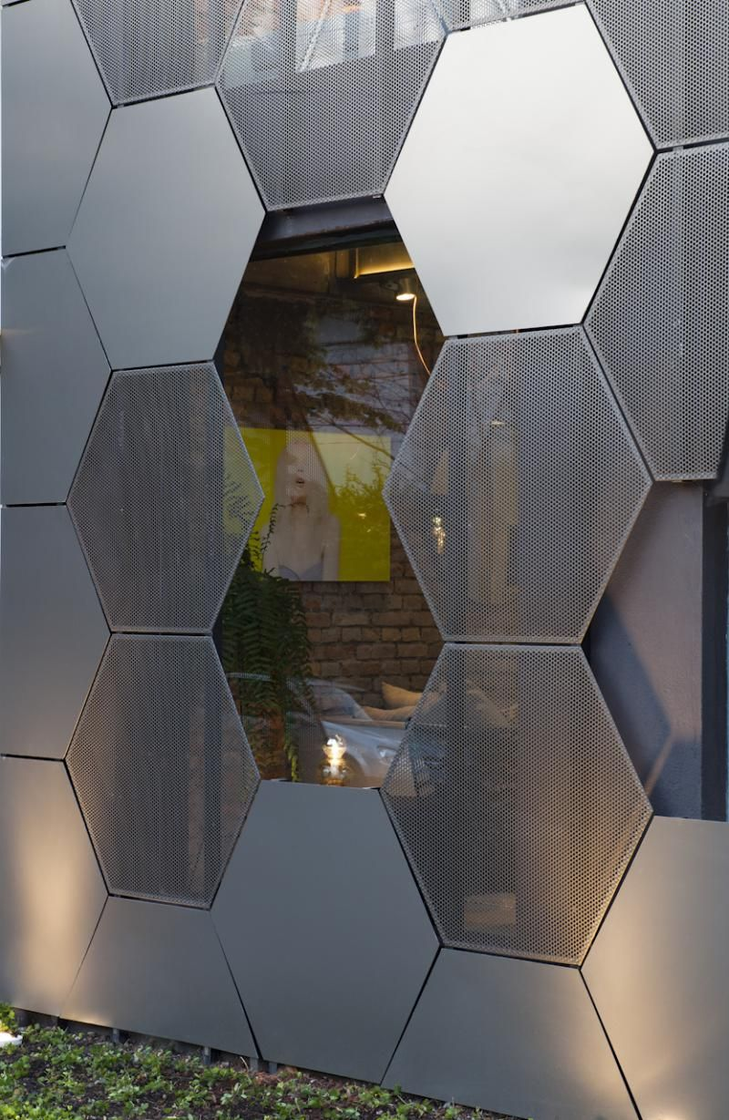 Superlimão studio have designed a honeycomb inspired facade full of hexagonal shapes for the estar móveis shop in são paulo brazil