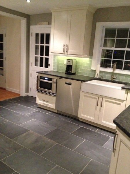 Attractive Apron Front White Farmhouse Sink With Vanilla Shaker Cabinets, Slate Gray  Flooring Green Backsplash