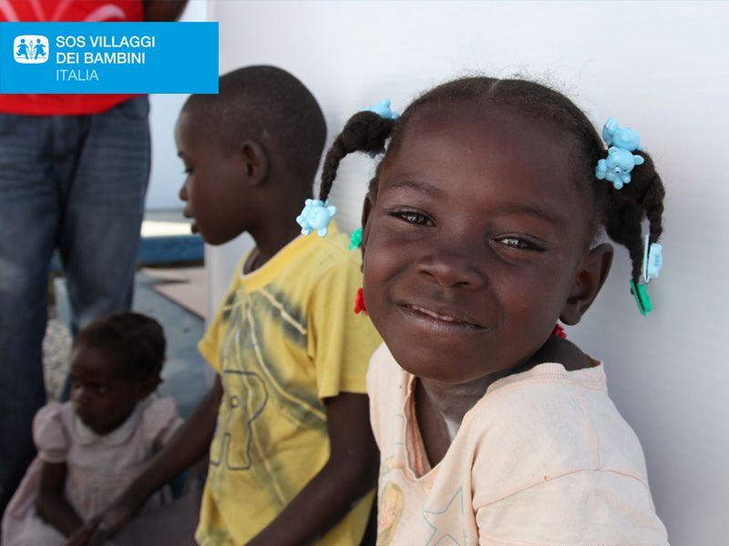 Bambina ospitata nel villaggio SOS di Port-au-Prince ad Haiti dopo il terremoto del 2010. Adozione a distanza SOS Villaggi dei Bambini