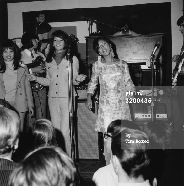 4th December 1966: American rock and roll group The Ronettes (left to right: Ronnie Bennett, Nedra Talley, and Estelle Bennett) performing on stage during a 'Freakout' party at the Action House disco, Island Park, Long Island, New York.