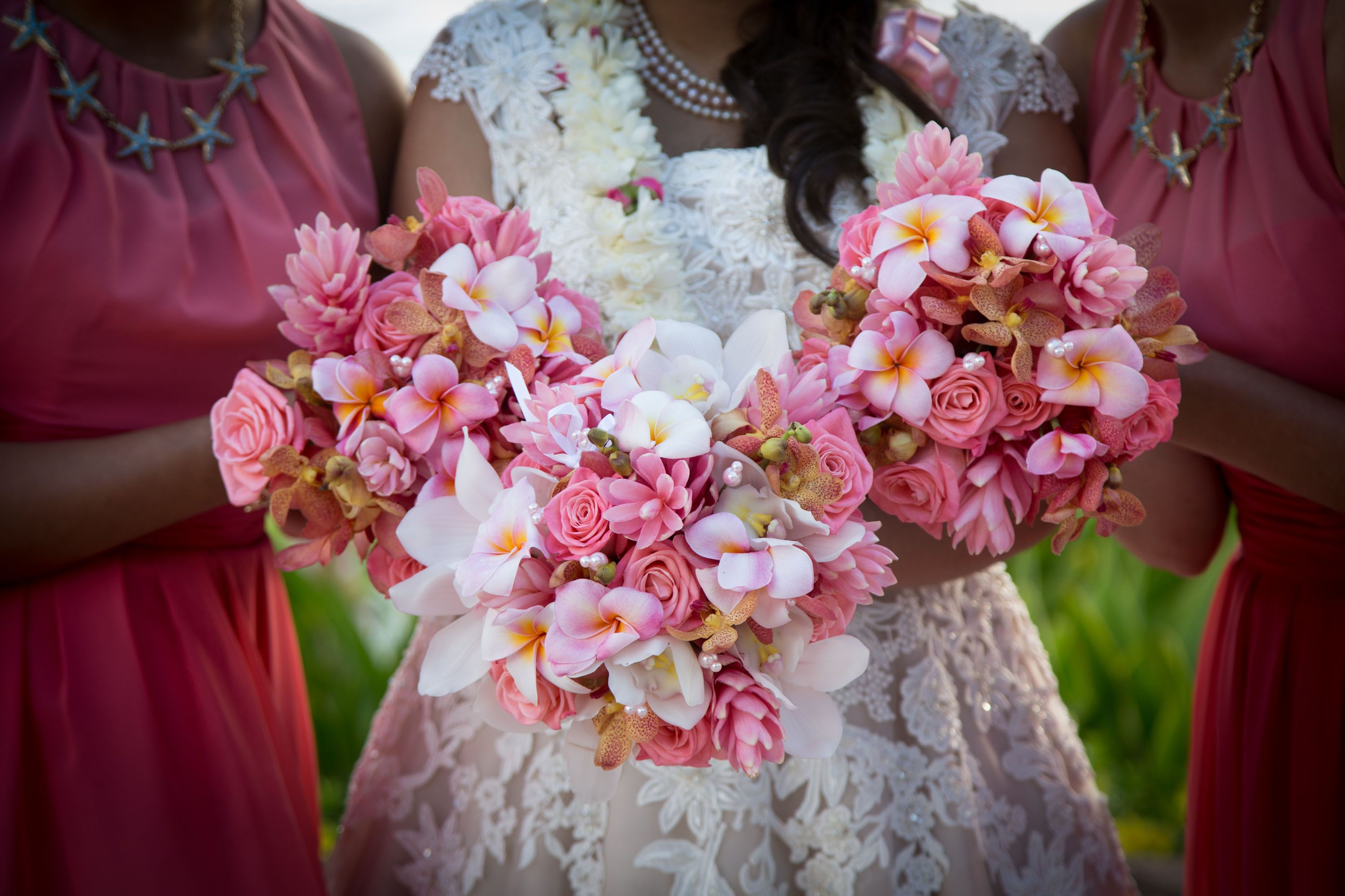 Tropical pink bride and bridesmaid bouquets for an Aulani wedding ...