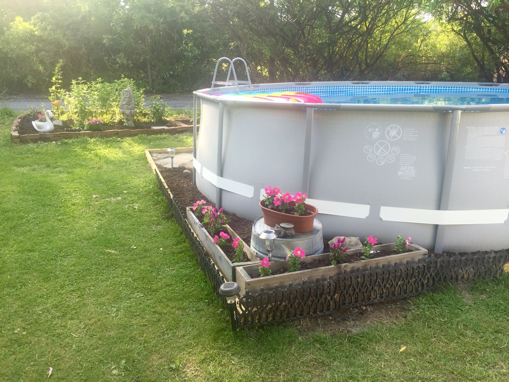 Did a little landscaping around our 14x42 Intex ultra frame pool ...