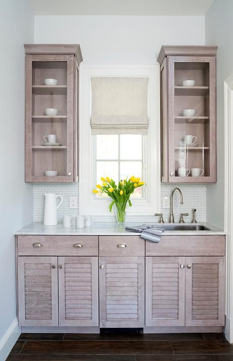 Chic butler's pantry features gray wash oak cabinets, upper cabinets ...