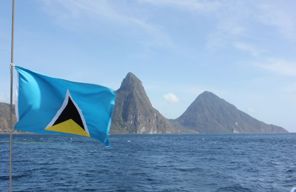 Saint Lucian Flag With The Pitons In The Background St Lucia Tour Around The World St Lucia Holiday