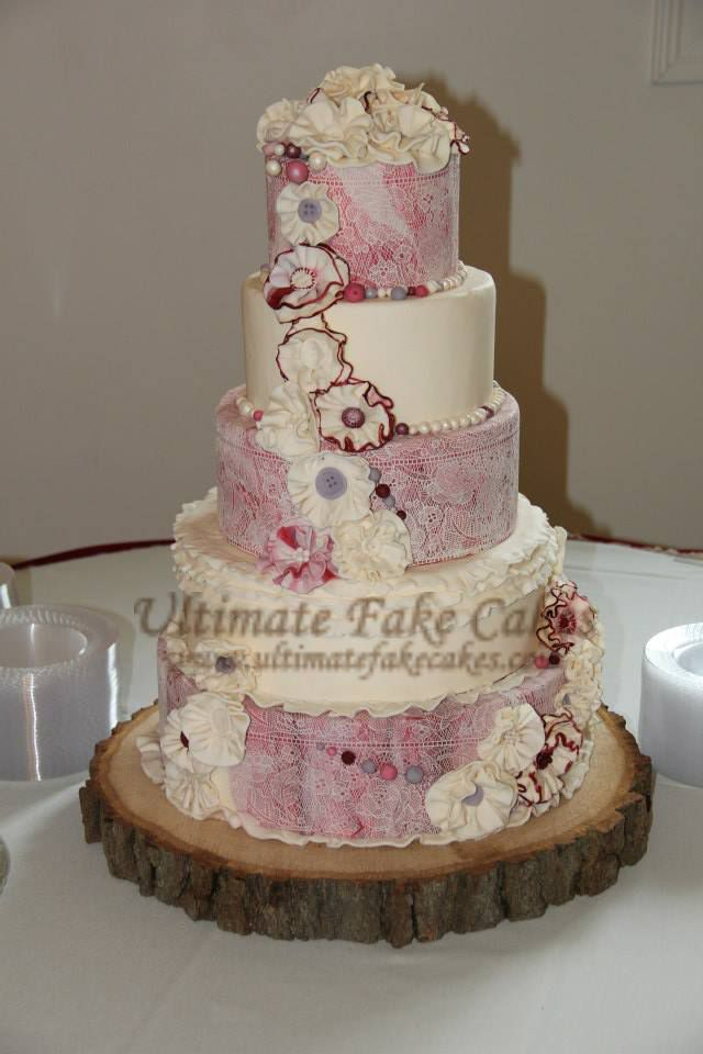 A 5-tier cake created for Stefanie's wedding day of Stefi G Photography.  https://www.facebook.com/stefig.photography www.ultimatefakecakes.com