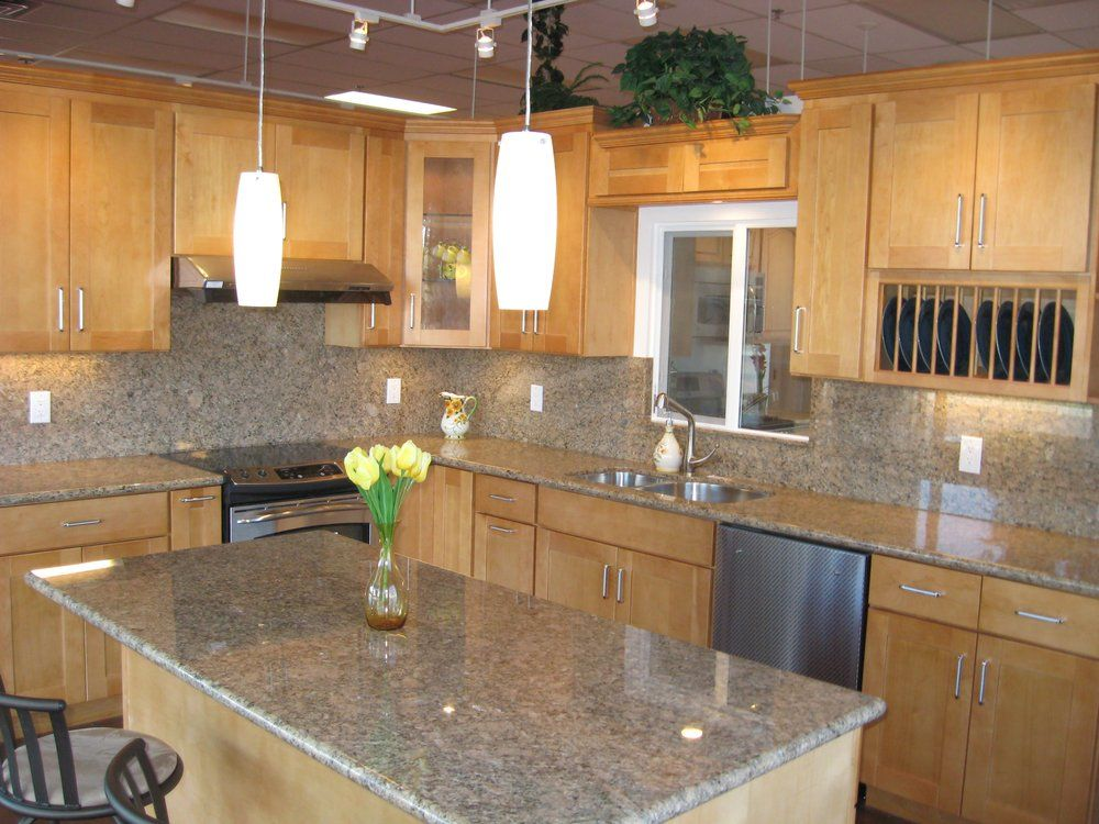 White Granite With Maple Cabinets