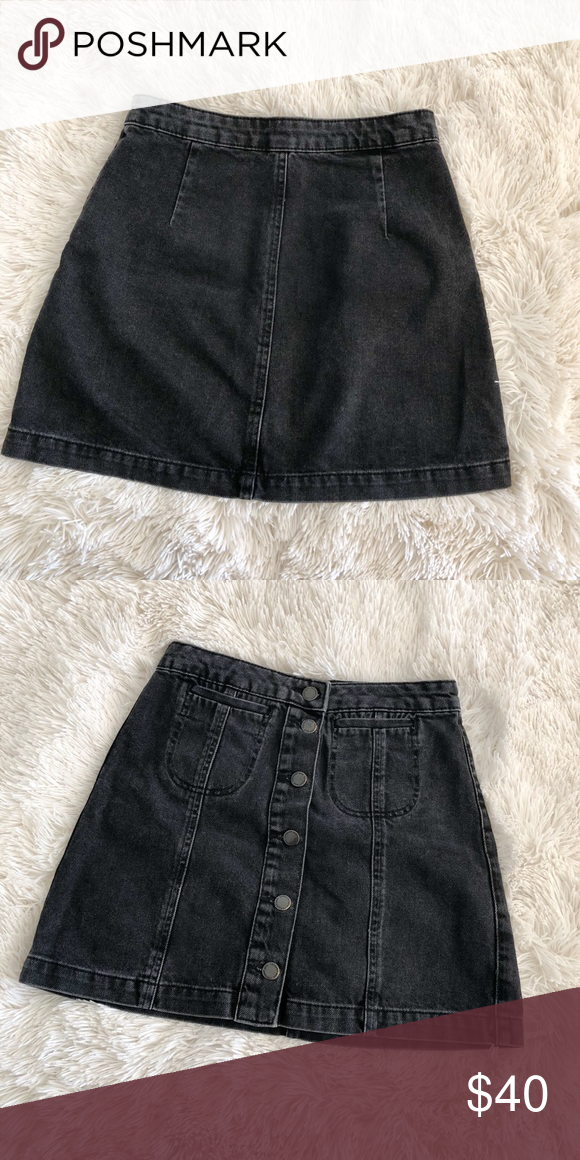 c458e06073 Topshop Black Button Skirt Super cute skirt! Goes with just about  everything. It is pretty high waisted and looks good with crop tops. No  stains or tears.