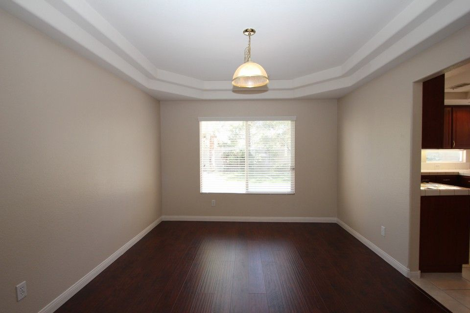 Hardwood Laminate Flooring In Living Room Family And Formal Dining Dark Cherry Wood Cabinets Kitchen Bathrooms