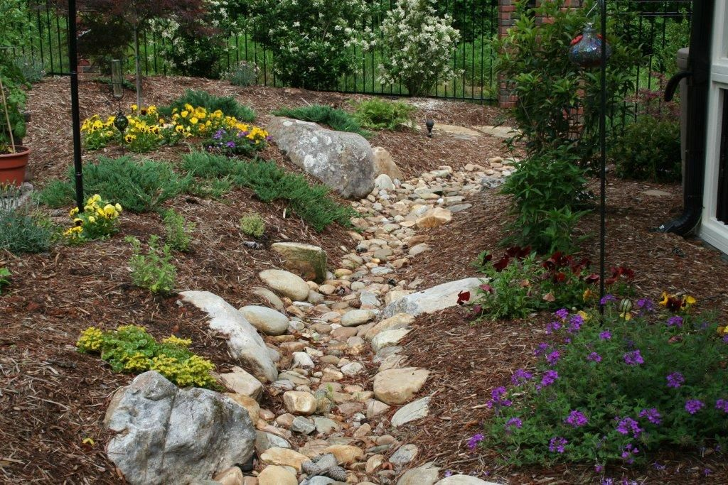 dry river bed from run off to rain garden Landscaping
