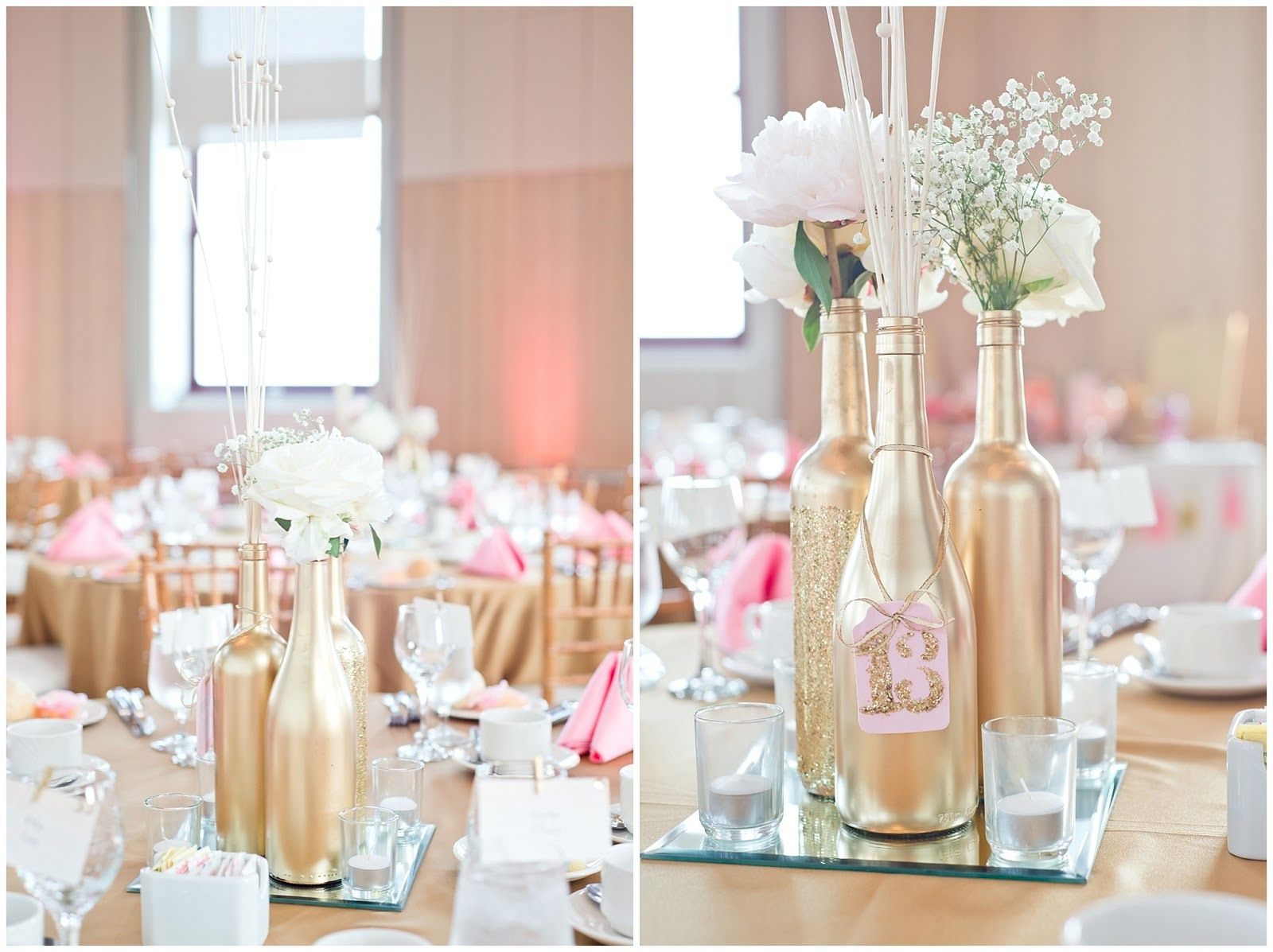 Gold painted wine bottle diy wedding centerpieces with white roses and pink  accents