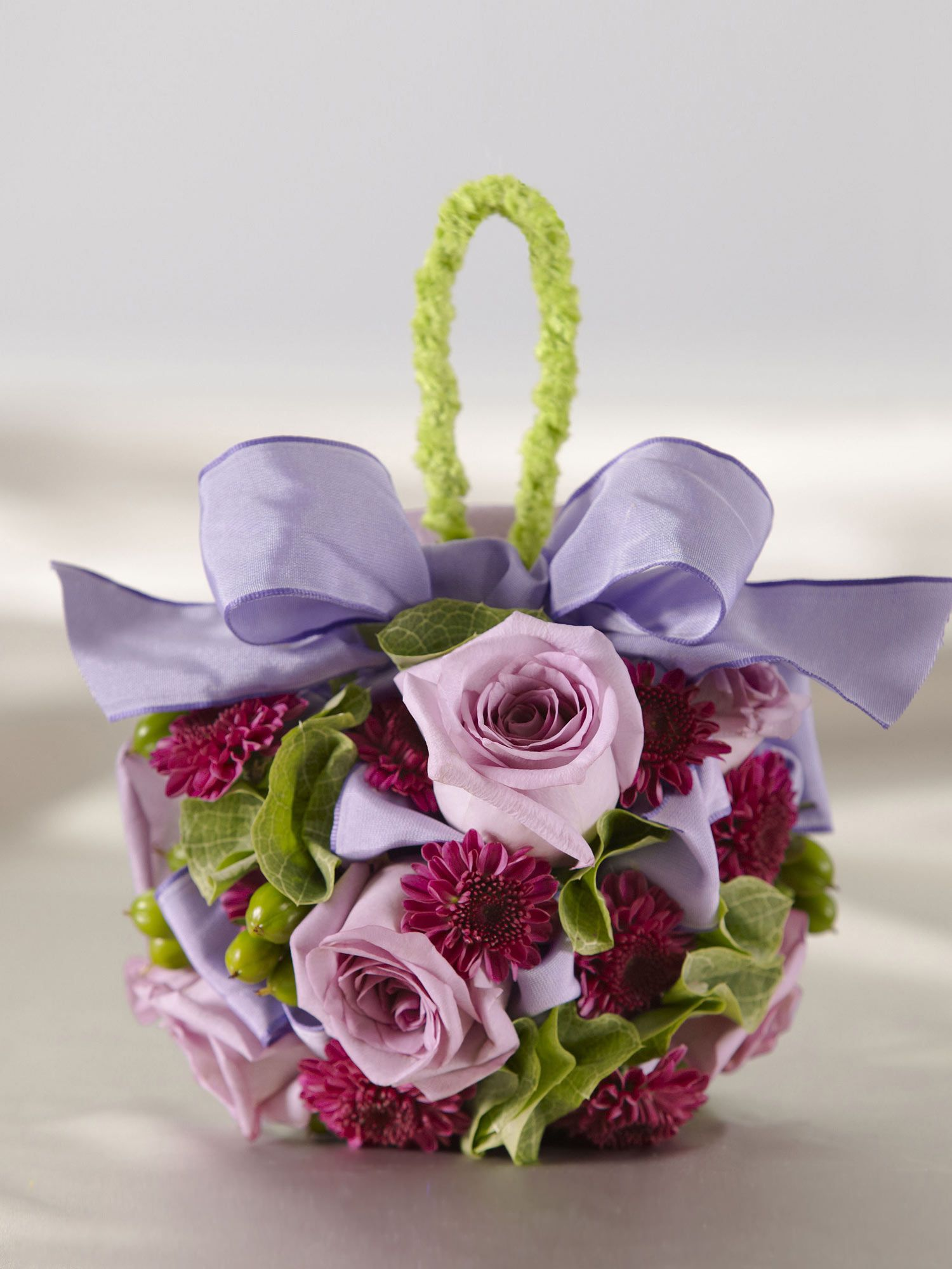 This pretty flower girl pomander is sweet alternative to a