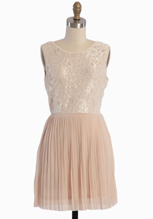 Love the delicate pleats and glowing lace on this beige dress. $52