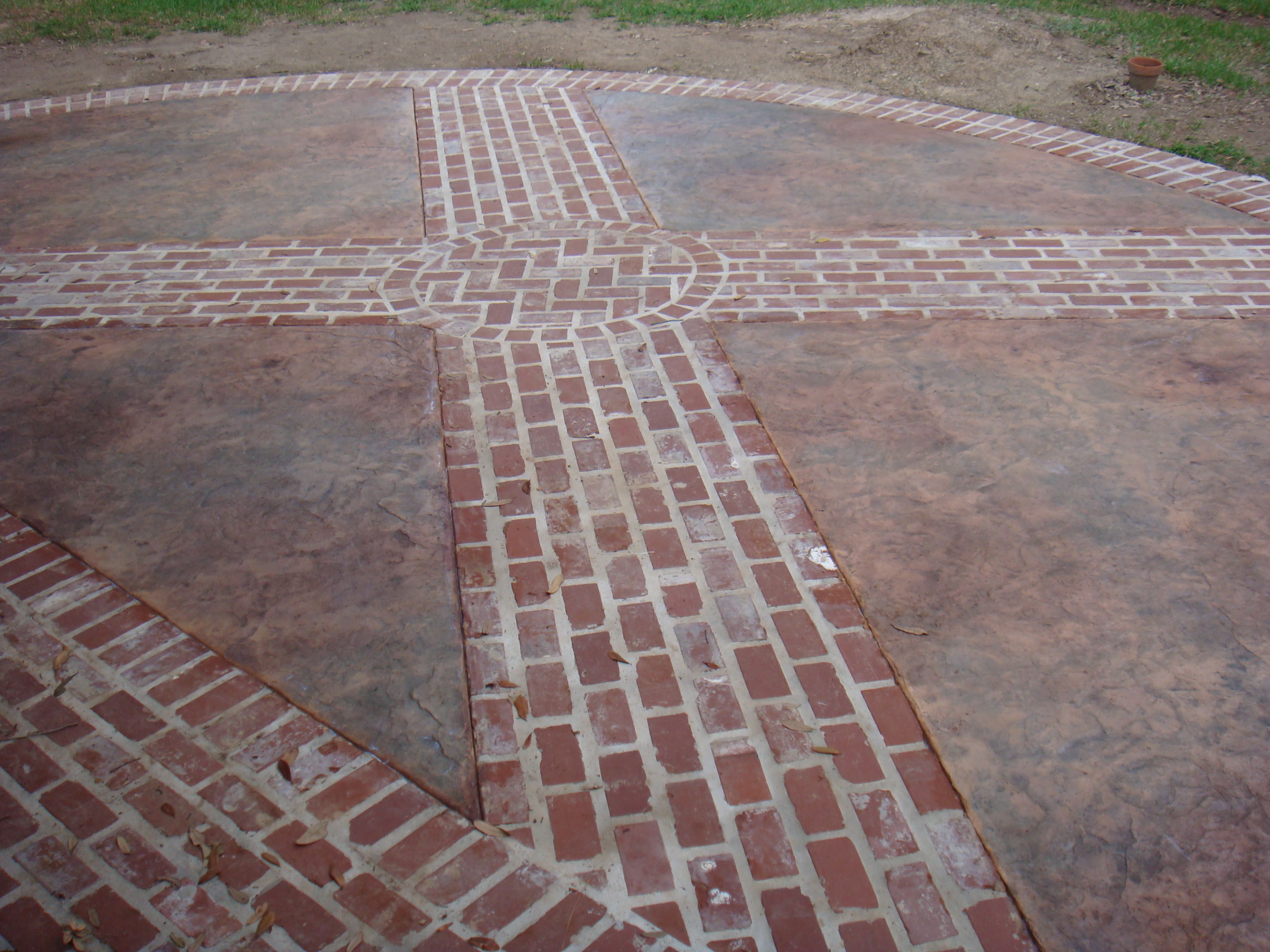 Stamped concrete to look like brick concrete is a very for Most economical flooring