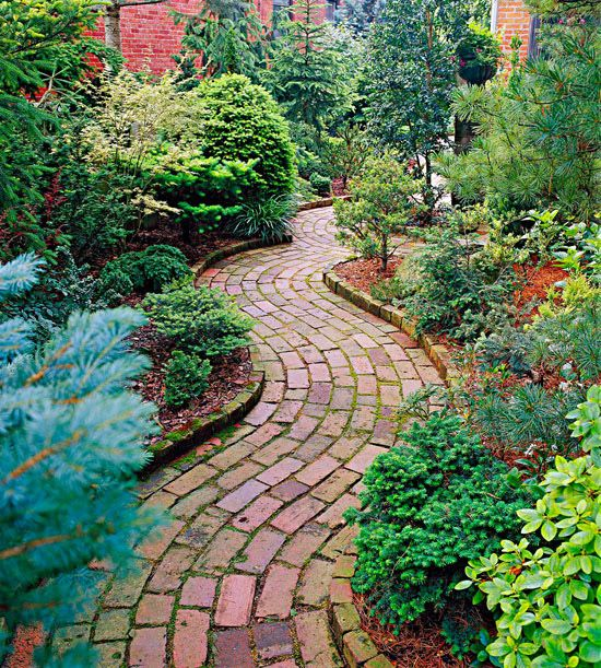A curved pattern adds a sense of movement to this charming garden path.