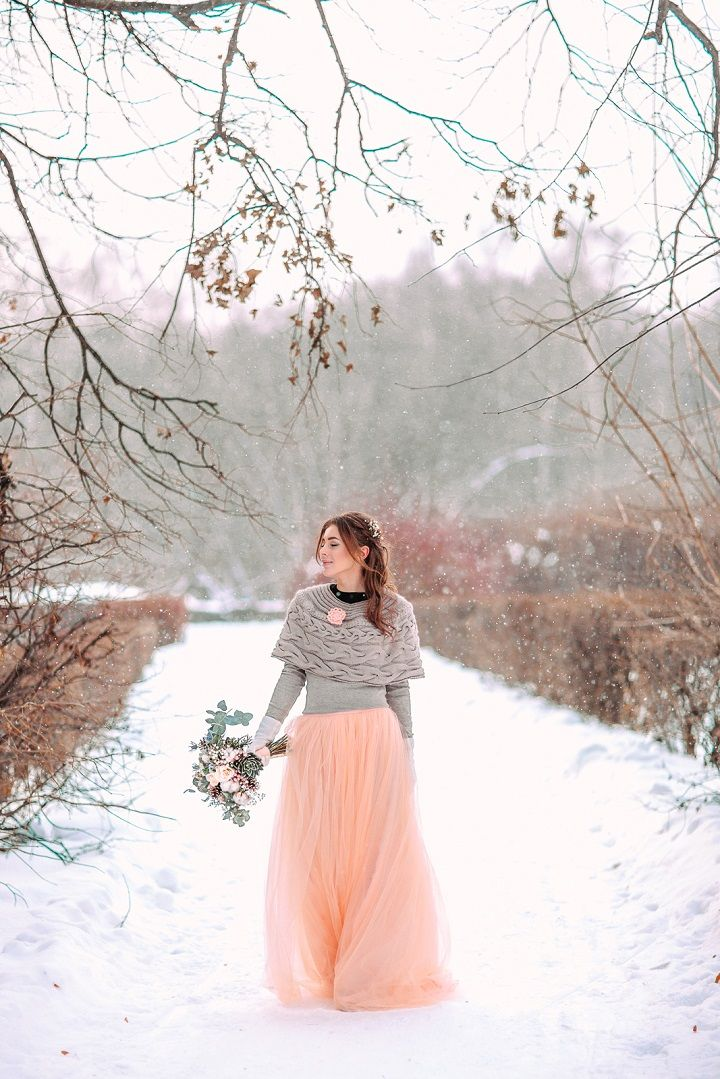 Peach wedding dress and grey knitwear cardigan | fabmood.com #wedding #winterwedding #outdoorwedding #snow #bride #weddingdress #peach