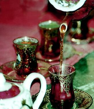 """Chai - Persian Tea in estekan-Persians are tea-lovers. In traditional Iranian homes, the Samaavar is on all day long. Tea is served in these small glasses called """"Estekaan"""" and matching saucers. These old-fashioned traditional estekaans display the portraits of 18th century Shahs of the Qajar Dynasty"""