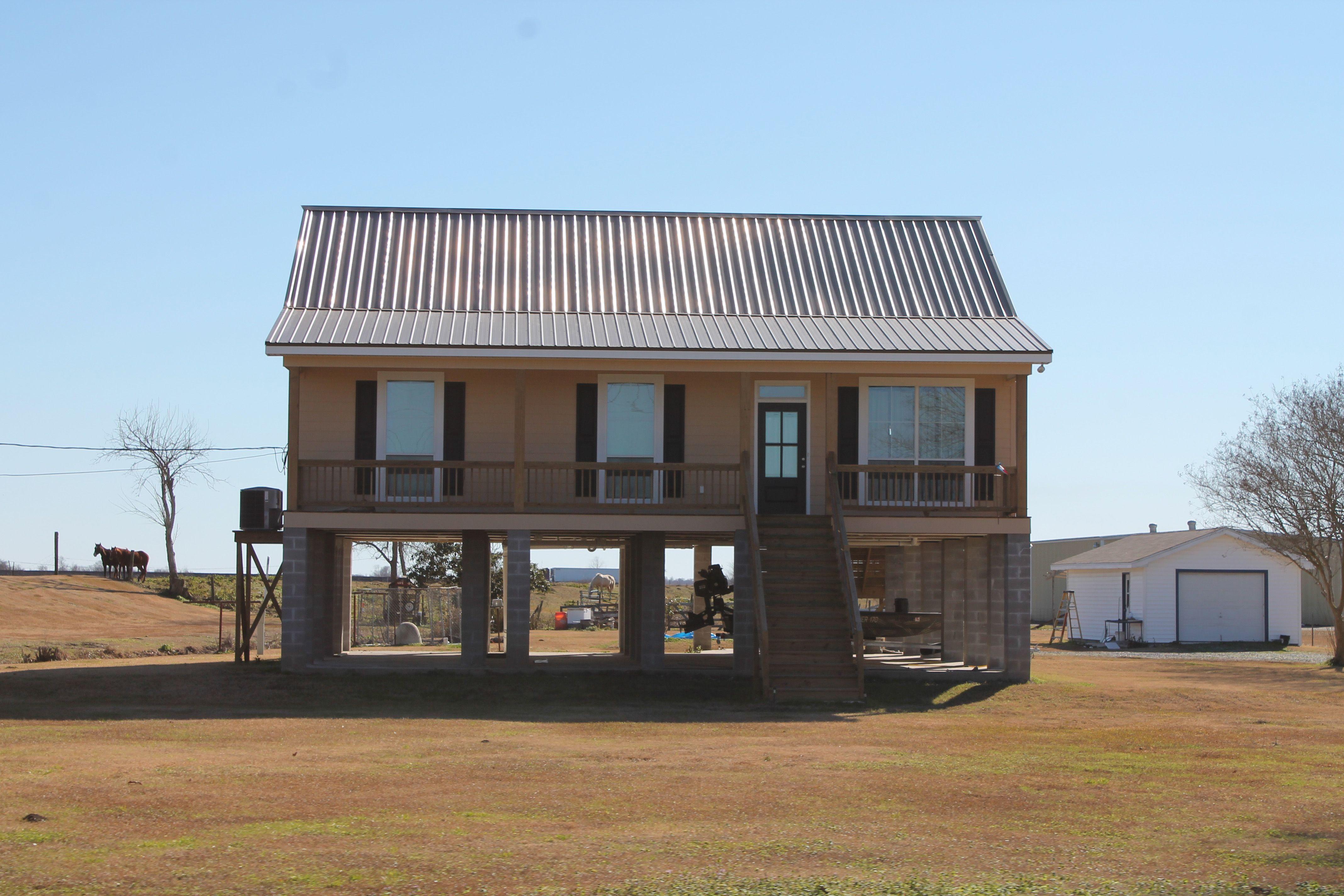 Raised vermillion house on stilts cretinhomes com