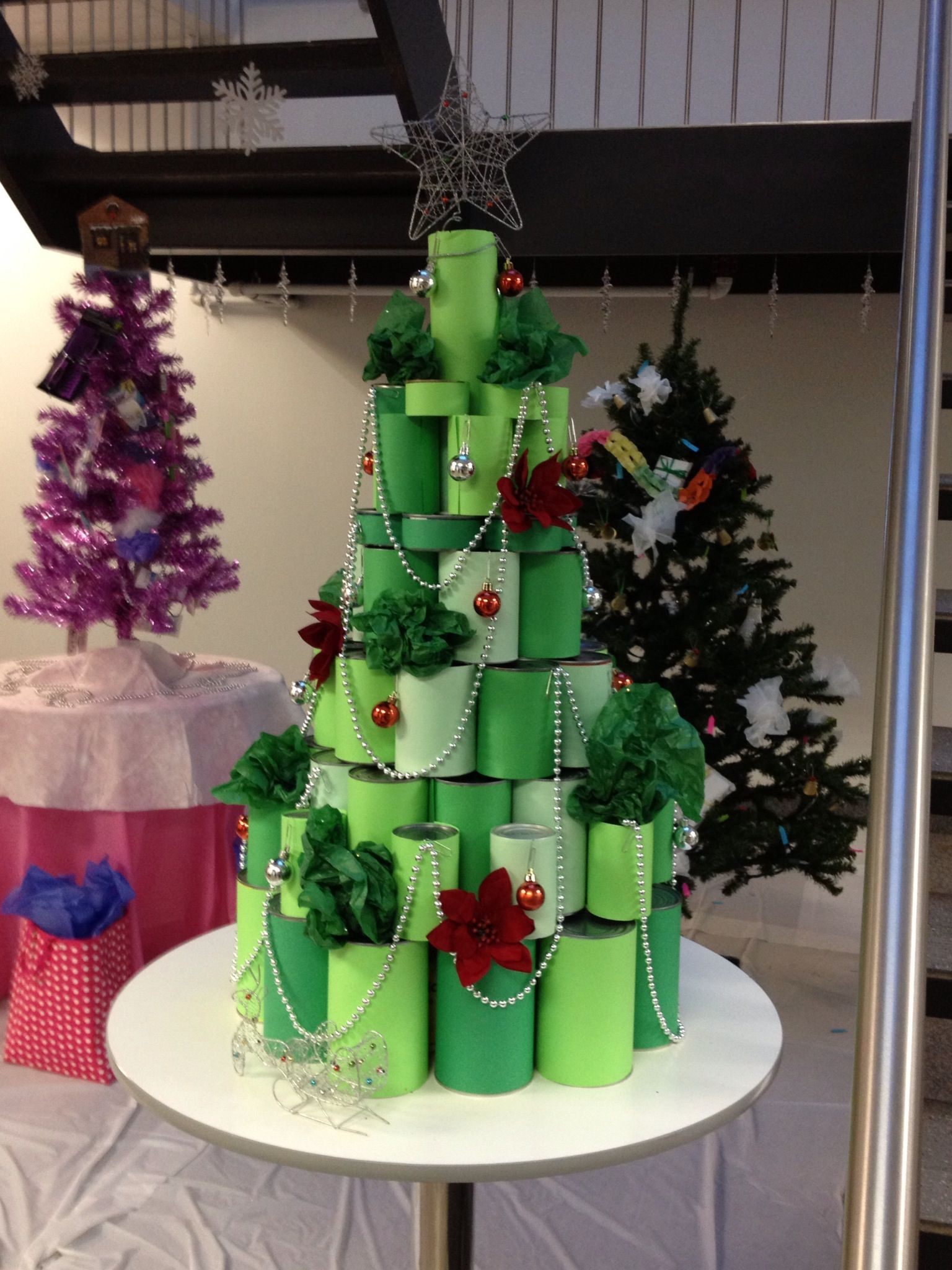 Cans covered in green paper stacked to represent a Christmas tree ...