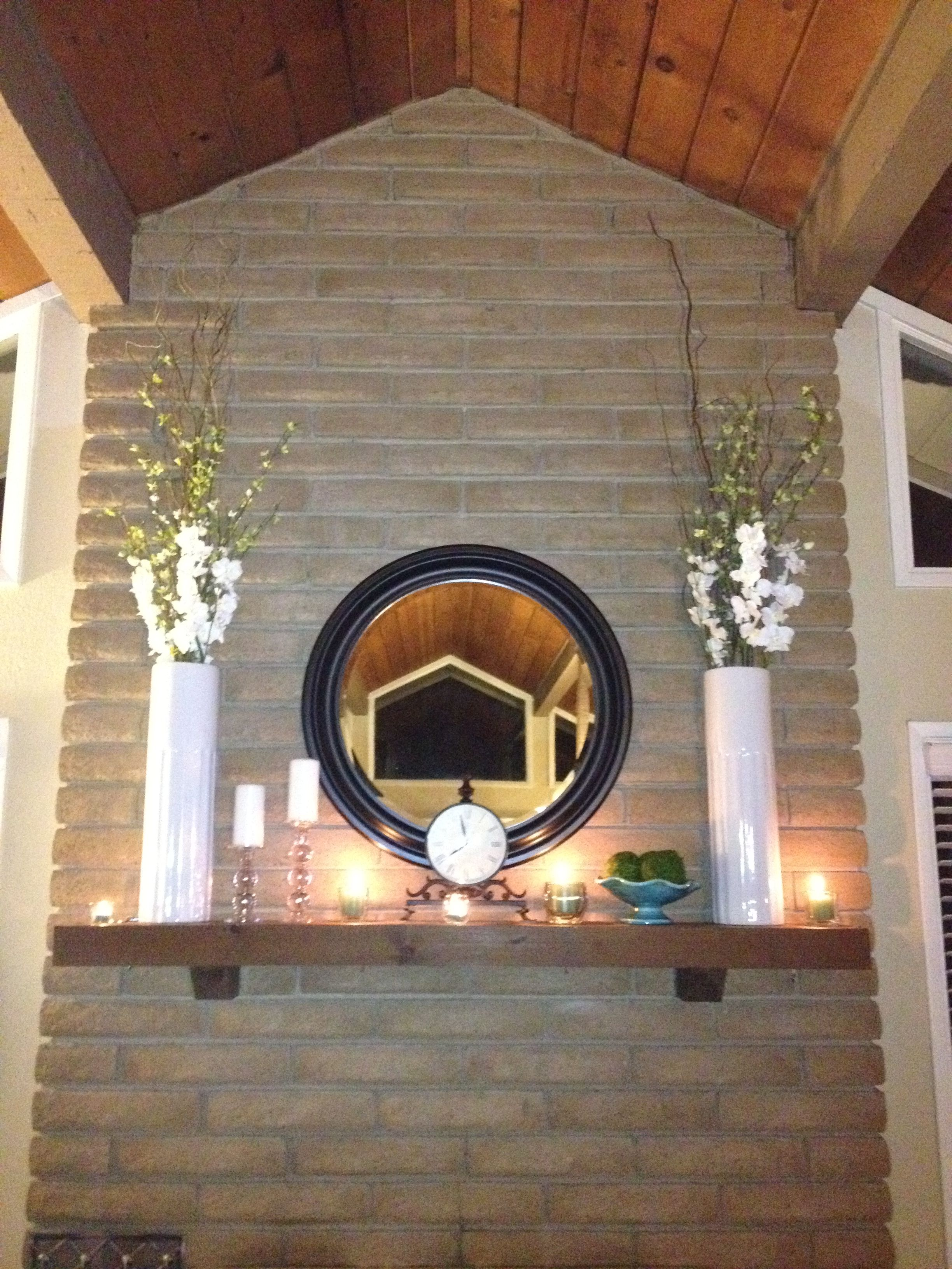 Mantle Love The Lights And Tall Flower Arrangements