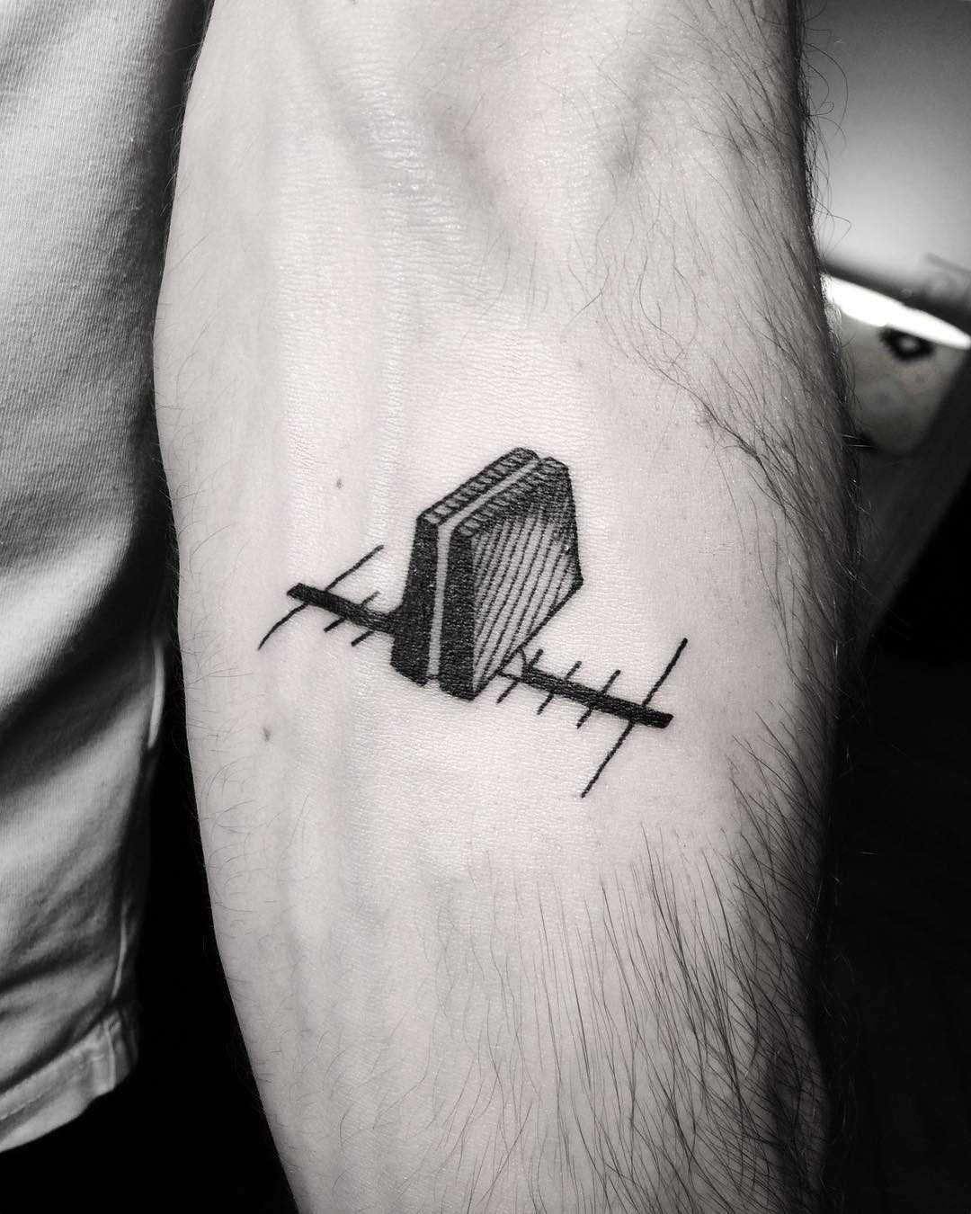 Crossfader tattoo inked on the left forearm | < Minimal
