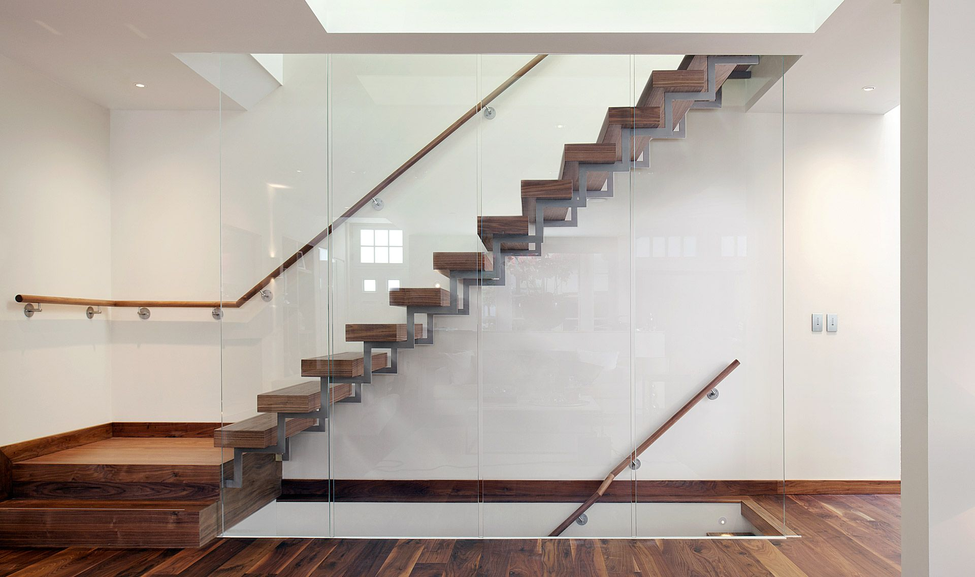 Magnificent floating stairs for your interior design and for Interior glass railing designs