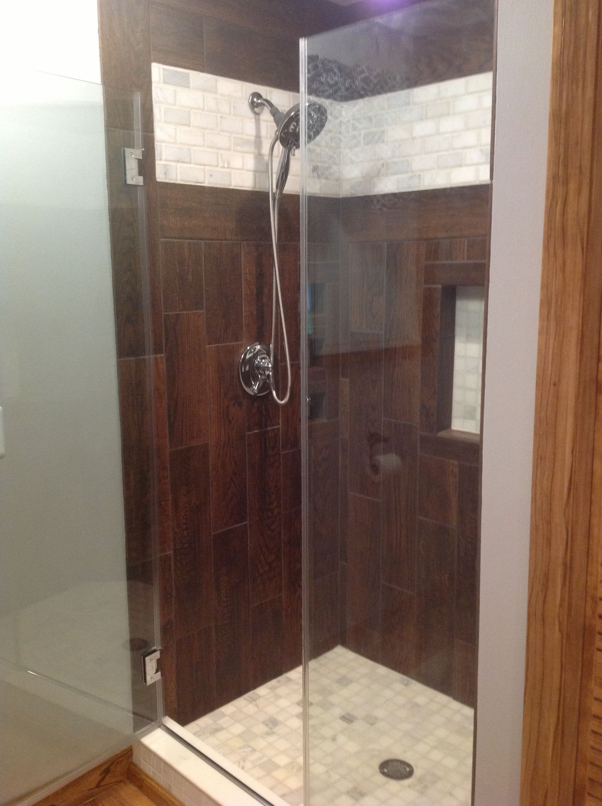 Ceramic tile that looks like wood. Shower stall. Downstairs ...