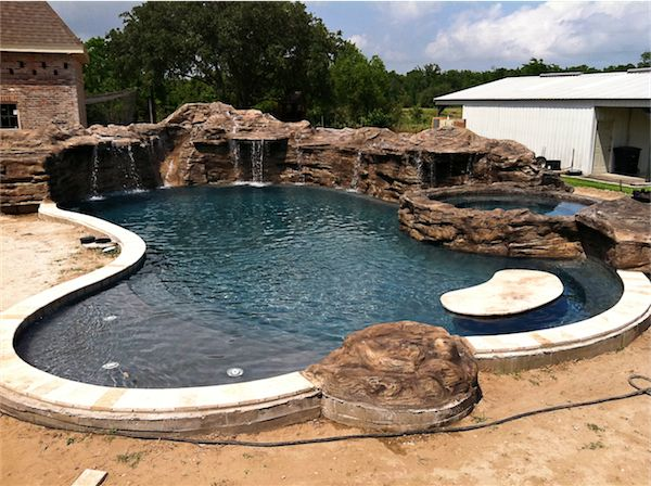 Volcanic rock slide fountain pool google search pool for Rock pool designs