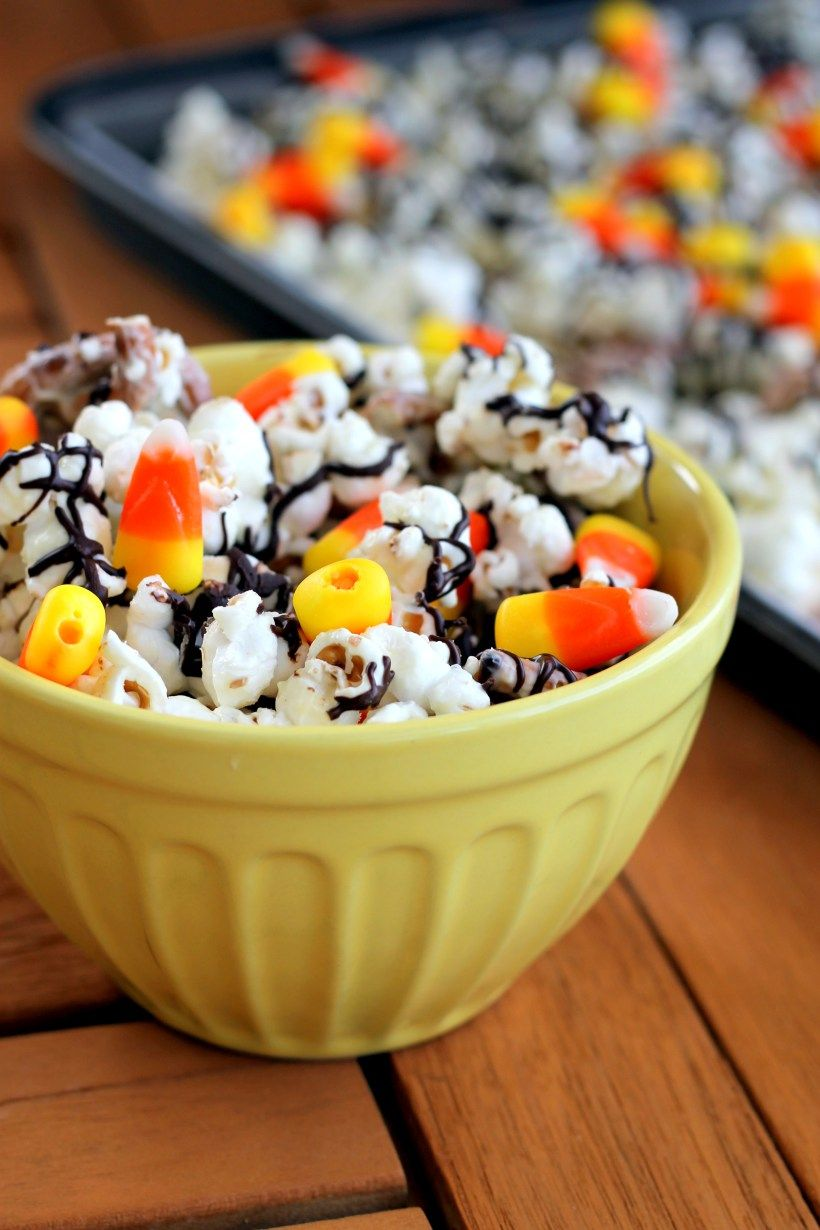 This White Chocolate Candy Corn Popcorn is tossed with pretzels, candy corn, white chocolate, and a drizzle of dark chocolate for a Halloween treat!