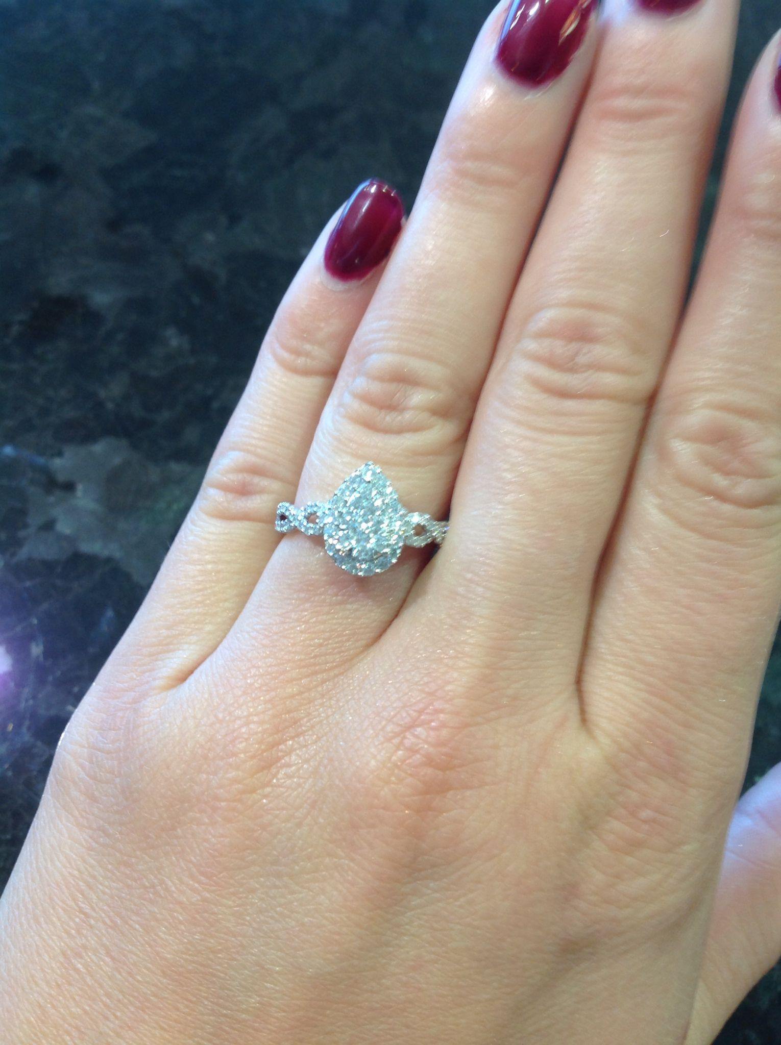This Pear Shaped Cluster Style Engagement Ring Features A